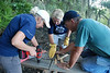 Sapelo Volunteer Projects : Building a boardwalk for UGA students to go out on the marsh and collect samples.  Also pictured is the clean up of the island greenhouse so it can eventually be restored to it's original state.